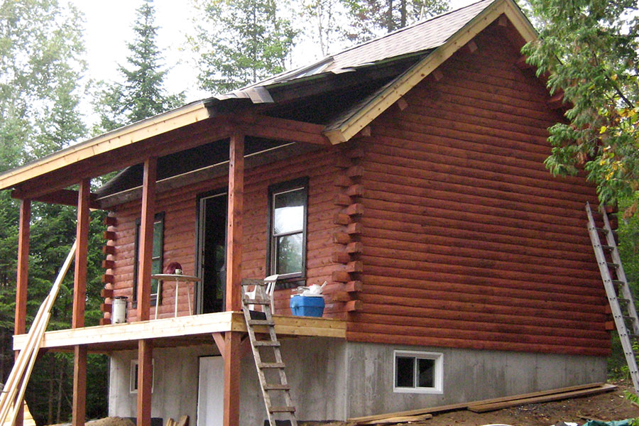 NH Log Cabin Home under construction
