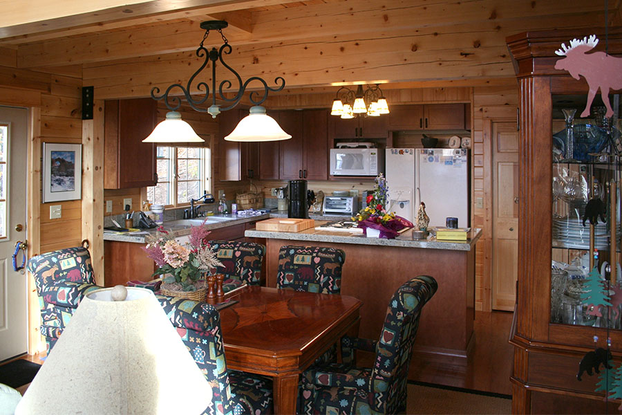 Dining room in a NH Log Cabin Home