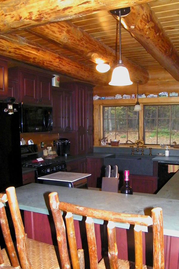 Kitchen with bar in a NH Log Cabin Home