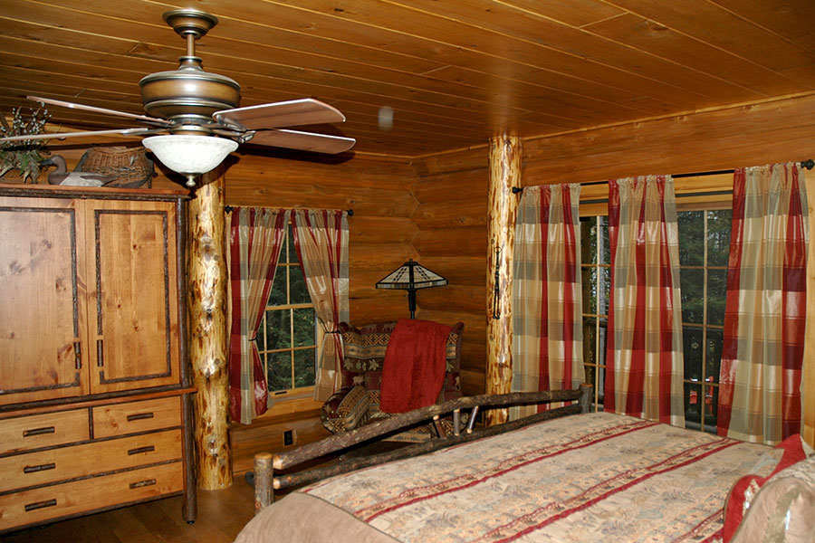 Bedroom in a NH Log Cabin Home