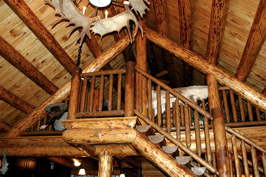 Foyer and staircase in a NH Log Cabin Home