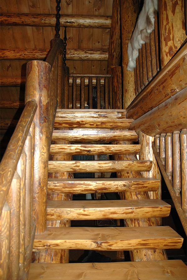 Interior staircase in a NH Log Cabin Home
