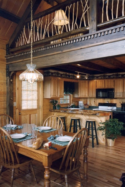 Dining room and kitchen in a NH Log Cabin Home