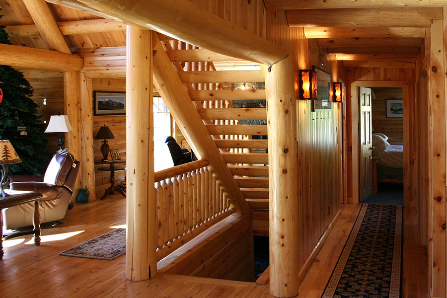 Hallway and staircase in a NH Log Cabin Home