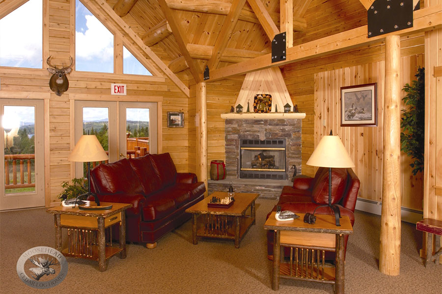 Great room and fireplace in a NH Log Cabin Home